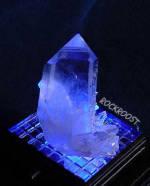 Arkansas Quartz Crystal Point #501 on LED light base with blue light shining through